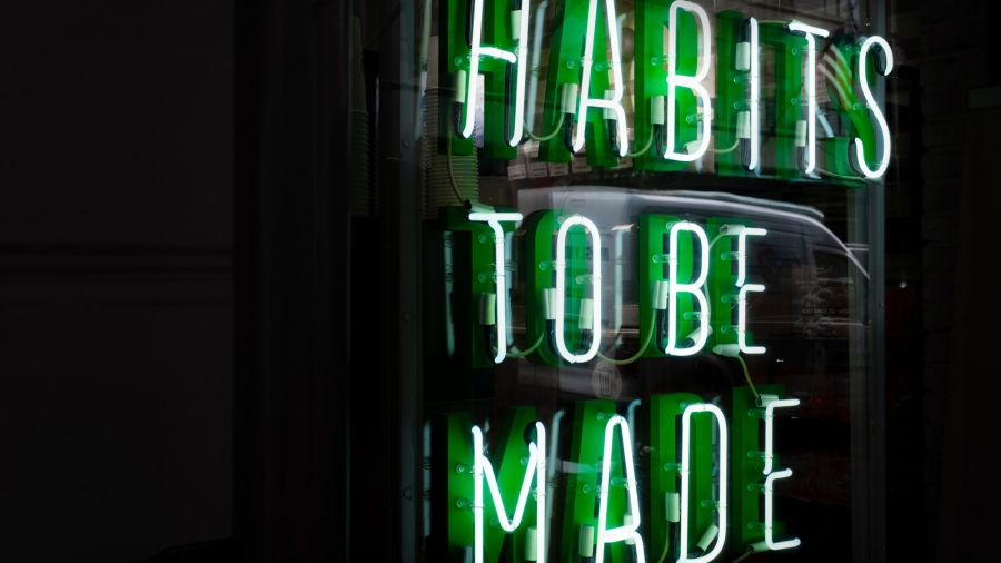 Green neon sign that reads: Habits to be made. Photo by Drew Beamer on Unsplash