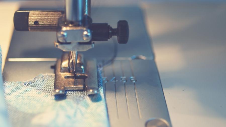 Sewing machine detail photo by J Williams on Unsplash